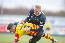 Falkirk's Zak Rubben over Partick Thistle's James Penrice. Falkirk 1 v 1 Partick Thistle, Scottish Championship game played 16/3/2019 at The Falkirk Stadium.