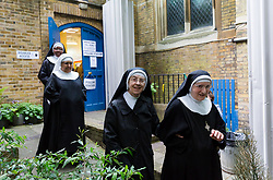 June 8, 2017 - London, London, UK - LONDON, UK.  Nuns arrive to vote in the general election at a polling station in St John's Hyde Park in London this morning. (Credit Image: © Vickie Flores/London News Pictures via ZUMA Wire)