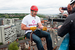 Fearless Plusnet Chief information Officer Mark Dundon steps off the top at the Plusnet and Hill Dickinson Charity Abseil 111 feet down the Balance building in Sheffield to raise money for Roundabout and Saint Lukes Hospice on Wednesday <br /> <br /> 11 June 2013<br /> Image © Paul David Drabble<br /> www.pauldaviddrabble.co.uk
