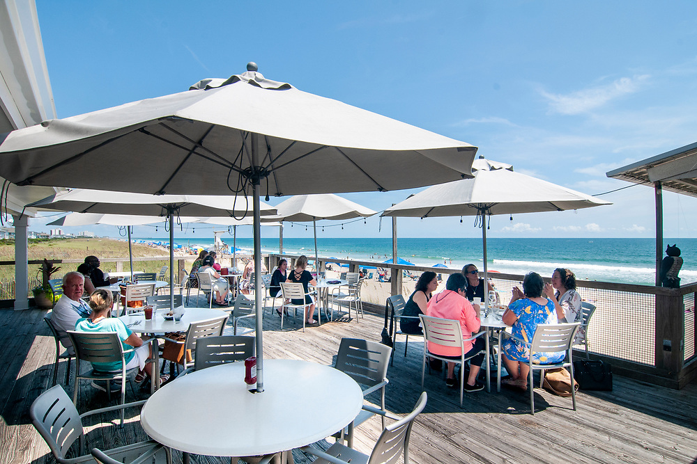 Outdoor seating at the Oceanic - a waterfront restaurant on an old fishing pier - in Wrightsville Beach, North Carolina on Tuesday, August 10, 2021. Copyright 2021 Jason Barnette