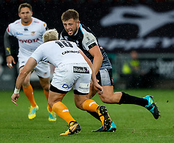 Scott Otten of Ospreys under pressure from Tiaan Schoeman of Cheetahs<br /> <br /> Photographer Simon King/Replay Images<br /> <br /> Guinness PRO14 Round 2 - Ospreys v Cheetahs - Saturday 8th September 2018 - Liberty Stadium - Swansea<br /> <br /> World Copyright © Replay Images . All rights reserved. info@replayimages.co.uk - http://replayimages.co.uk