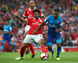 July 29, 2017 - London, United Kingdom - Arsenal's Theo Walcott gets tackled by Eliseu of Sporty Lisboa e Benfica.during Emirates Cup match between RB Arsenal against Benfica  at Emirates Stadium on 29 July 2017  (Credit Image: © Kieran Galvin/NurPhoto via ZUMA Press)