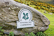 The National Trust sign on Abergwesyn common, in the Carneddau which rises immediately south of the village of Abergwyngregyn just inside the northern boundary of the Snowdonia National Park and 4 km west-south-west of Llanfairfechan. Gwynedd, North Wales.