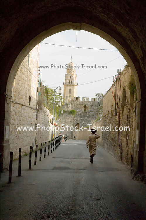 Israel, Jerusalem, Old City, Arched passage, Ultra religious Jew and a church steeple in the background a conceptual shot combining elements of Jerusalem