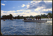 Henley, Great Britain, Men's Quadruple Sculls Racing past Temple Meadow, Followed by the Umpires Launch, Magician, 1988 Henley Royal Regatta, Henley Reach, River Thames, Annual Event. [Mandatory credit: Peter Spurrier/Intersport Images]