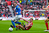 Lee Cattermole of Sunderland (6) tackles Ronan Curtis of Portsmouth (11) during the EFL Sky Bet League 1 first leg Play Off match between Sunderland and Portsmouth at the Stadium Of Light, Sunderland, England on 11 May 2019.
