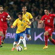 Turkey's Ozan Tufan (R) and Brazil's Neymar JR (F) during their a international friendly soccer match Turkey betwen Brazil at Sukru Saracoglu Arena in istanbul November 12, 2014. Photo by Aykut AKICI/TURKPIX