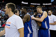 Kristaps Porzingis #46 of the New York Knicks hugs the San Antonio Spurs after an NBA Summer League game in Las Vegas, Nevada on July 11, 2015. (Cooper Neill for The New York Times)