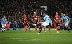 Manchester City's Gabriel Jesus (centre) scores his side's second goal of the game from the penalty spot