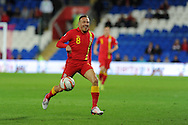 Craig Bellamy of Wales makes a break. FIFA World cup 2014 qualifying match, Wales v Macedonia at the Cardiff city stadium in Cardiff on Friday 11th October 2013 pic by Andrew Orchard, Andrew Orchard sports photography,