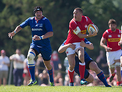 June 16, 2018 - Ottawa, ON, U.S. - OTTAWA, ON - JUNE 16: Nick Blevins (12 Centre ) of Canada passes the ball as tackled by a Russian player in the Canada versus Russia international Rugby Union action on June 16, 2018, at Twin Elms Rugby Park in Ottawa, Canada. Russia won the game 43-20. (Photo by Sean Burges/Icon Sportswire) (Credit Image: © Sean Burges/Icon SMI via ZUMA Press)