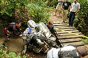 Bill Dragoo and Brad ? push from behind while Jim Stoddard pulls from the front and Briene Thompson rides an R1200GS out of a creek bed at the BMW GS Trophy Challenge in Spartanburg, SC