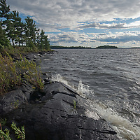 Waves crash onto the shore of an island on Lake of the Woods,  Ontario, Canada.