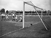 14/09/1952<br /> 09/14/1952<br /> 14 September 1952<br /> Soccer: Waterford v Transport at Harolds Cross Park, which Waterford won. Transport score a goal.