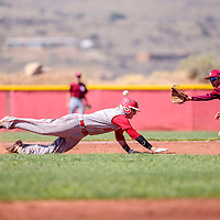 Grants Pirate Austin Hall (5), left, dives back to second base before Sandia Prep Sundevil Antonio Avila (9) can make a tag in Grants Tuesday.