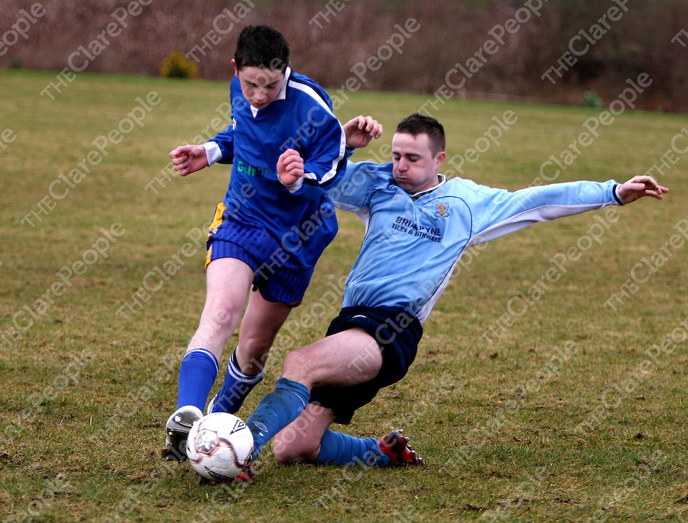 Mark Woods and Shane Mangan in action during the Turnpike V St Pats match at Kilmihil on Sunday.<br /> <br /> Photograph by Eamon Ward