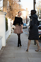 Leila Russack (singer/songwriter) taking her dog for a walk in Chelsea, wearing vintage Givenchy earrings, vintage YSL belt, Alaia Snow Leopard skirt and her favourite Wolford stockings. photo by Terry Scott