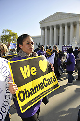 March 27, 2012 - Washington, District of Columbia, U.S. - Protestors supporting and opposed to President Obama's health care reform - or ''Obamacare'' - gather outside the U.S. Supreme Court on the second day of oral arguments in lawsuits over the law. .(Credit Image: © Jay Mallin/ZUMAPRESS.com)