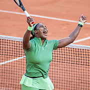 PARIS, FRANCE June 2.  Serena Williams of the United States celebrates holding her serve late in the game during her victory against Miahaela Buzarnescu of Romania on Court Philippe-Chatrier during the second round of the singles competition at the 2021 French Open Tennis Tournament at Roland Garros on June 2nd 2021 in Paris, France. (Photo by Tim Clayton/Corbis via Getty Images)
