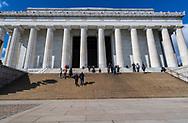 Washington, DC, USA -- February 14, 2020. A  wide angle photo of tourists climbing  the steps of the Lincoln Memorial.