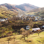 View of Botiza village, Maramures, Romania. In the Romanian Carpathians, the agricultural landscape consists of a diverse mixture of small fields, meadows and orchards situated around villages, interspersed with forest and woodlands.