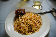 Monk brother priest Riccardo Casagrande's dinner of spaghetti on his table at the San Marcello al Corso Church in Rome, Italy, near the Spanish Steps. (Riccardo Casagrande is featured in the book What I Eat: Around the World in 80 Diets.)  Casagrande is in charge of the kitchen, garden, and wine cellar for the brotherhood.