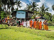 20 JUNE 2016 - DON KHONE, CHAMPASAK, LAOS:  A funeral procession takes a recently deceased man to his cremation near Don Khone village on Don Khone Island. Don Khone Island, one of the larger islands in the 4,000 Islands chain on the Mekong River in southern Laos. The island has become a backpacker hot spot, there are lots of guest houses and small restaurants on the north end of the island. In the southern Lao funeral tradition, the deceased is cremated at the place of his choosing, usually a place he (or she) was especially fond of. In this case, the man chose to be cremated in a small clearing in the jungle a few kilometers from his home.    PHOTO BY JACK KURTZ