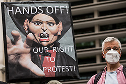 London, UK. 1st May, 2021. A protester holds a sign outside the Home Office featuring an image of Home Secretary Priti Patel during a Kill The Bill demonstration as part of a National Day of Action to mark International Workers Day. Nationwide protests have been organised against the Police, Crime, Sentencing and Courts Bill 2021, which would grant the police a range of new discretionary powers to shut down protests.