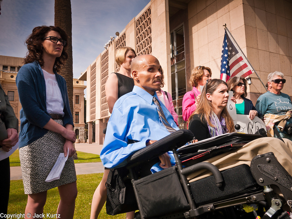 06 FEBRUARY 2012 - PHOENIX, AZ:  DAVID CAREY (center) and JENNIFER LONGDON, both survivors of gun violence, prepare to speak out against allowing guns on college campuses during a press conference at the Arizona State Senate on Monday, Feb. 6. The Arizona State Senate's Judiciary Committee, chaired by Sen Ron Gould (Republican) debated several bills Monday that would loosen the state's gun laws, already among the loosest in the United States. One bill would allow anyone with a concealed carry permit to carry guns on the grounds of public universities. Universities could only ban guns if they provided secured gun lock boxes in each building. Universities, which are opposed to the legislation, say that the lock boxes would cost hundreds of thousands of dollars and that guns would make the campuses less safe. Most of the police departments in Arizona, as well as university student bodies, also oppose the legislation to allow guns on campus.     PHOTO BY JACK KURTZ
