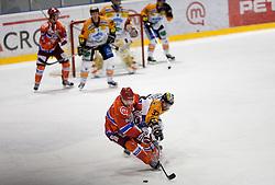Jason Beckett of Tilia Olimpija vs Stefan Herzog of Graz during ice hockey match between HK Acroni Jesenice and  Moser Medical Graz 99ers in 24th Round of EBEL league, on December 3, 2010 in Arena Podmezakla, Jesenice, Slovenia.  (Photo By Vid Ponikvar / Sportida.com)