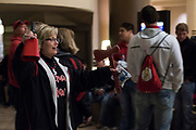 Lori Chaney rings her cow bell for the Iraan High School football team before they boarded the busses to the state championship game at AT&T Stadium in Arlington, Texas on December 15, 2016. (Cooper Neill for The New York Times)