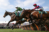TheClockIsTicking ridden by Ciaran Gethings (14) and Vive Le Roi (19) ridden by Harry Bannister lead the way over the first hurdle in the  1:45pm The Gaskells Handicap Hurdle (Grade 3) during the Grand National Meeting at Aintree, Liverpool, United Kingdom on 6 April 2019.