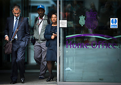 """© London News Pictures. 27/06/2013. London, UK. Lawyer IMRAN KHAN, STUART LAWRENCE and DOREEN LAWRENCE, leaving the Home Office in London after meeting with Home Secretary Theresa May for talks following claims police tried to """"smear"""" the family in the wake of the 1993 murder of Stephen Lawrence. Photo credit: Ben Cawthra/LNP"""