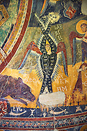 Second half of the twelfth Century Romanesque frescoes of the Apse d'Esterri de Cardos depicting a Byzantine style angel. The church of Sant Pau d'Estirri de Cardos, Spain. National Art Museum of Catalonia, Barcelona. MNAC 15970 .<br /> <br /> If you prefer you can also buy from our ALAMY PHOTO LIBRARY  Collection visit : https://www.alamy.com/portfolio/paul-williams-funkystock/romanesque-art-antiquities.html<br /> Type -     MNAC     - into the LOWER SEARCH WITHIN GALLERY box. Refine search by adding background colour, place, subject etc<br /> <br /> Visit our ROMANESQUE ART PHOTO COLLECTION for more   photos  to download or buy as prints https://funkystock.photoshelter.com/gallery-collection/Medieval-Romanesque-Art-Antiquities-Historic-Sites-Pictures-Images-of/C0000uYGQT94tY_Yk