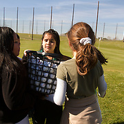 The First Tee of Monterey County opens the door to golf, as well as academic tutoring,  to many underprivileged kids of Salinas, CA, which is located only miles from the affluent golf haven, Pebble Beach. Kids race to collect the golf balls after a drill.
