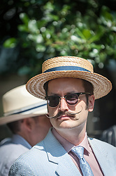 A chap sports a magnificent moustache at the Chap Olympiad. 2014. An annual event celebrating Britain's sporting ineptitude. Bedford Square, London