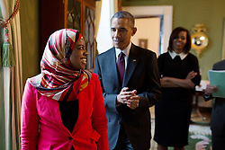 Harvard student Saheela Ibraheem looks back at President Barack Obama and First Lady Michelle Obama in the Green Room as she prepares to enter the East Room of the White House to introduce them at a reception celebrating Black History Month, Feb. 26, 2015. (Official White House Photo by Pete Souza)<br /> <br /> This official White House photograph is being made available only for publication by news organizations and/or for personal use printing by the subject(s) of the photograph. The photograph may not be manipulated in any way and may not be used in commercial or political materials, advertisements, emails, products, promotions that in any way suggests approval or endorsement of the President, the First Family, or the White House.