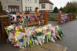 © Licensed to London News Pictures. 03/02/2013. Bristol, UK.  Vigil for Ross and Clare Simons.  People at the vigil were asked to bring cans of Blackthorn cider and Fosters lager, the couple's favourites, and to write messages to the couple.  More than 200 people attend a vigil at the scene where two cyclists, husband and wife Ross and Clare Simons, died after they were involved in a hit and run accident on 27 January with a vehicle in Lower Hanham Road, Hanham, Bristol.  The police have said they tried to flag the vehicle down before the accident because it was going at speed. 03 February 2013..Photo credit : Simon Chapman/LNP