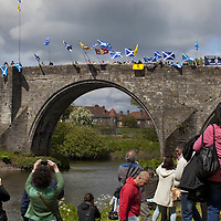 """BRAVEHEART HEROES, WILLIAM WALLACE AND ANDREW DE MORAY, FINALLY HONOURED AT STIRLING BRIDGE BATTLE SITE AS SALTIRE RAISED FOR FIRST TIME IN OVER 700 YEARS<br /> <br /> Friday 29th May, 2015<br /> <br /> IT'S TAKEN more than 700 years but today, the two heroes at the centre of one of the most important battles in Scottish history have been jointly honoured at the spot where they both led an outnumbered Scottish army to victory against the English.<br /> The formal unveiling ceremony at Stirling Bridge today (Friday 29th May), of three lecterns made of traditional Scottish whinstone dedicated to the memory of William Wallace and Andrew de Moray,at site of the historic victory at Battle of Stirling Bridge.<br /> At a special ceremony attended by Andrew de Moray's direct descendant, the Earl of Moray, and Stewart Maxwell, MSP, convener of the Scottish Parliament's Education and Culture Committee, the memorials were formally unveiled.Mr Maxwell opened the event and after the dedication, together with the Earl of Moray, they raised the Saltire together at the site of the Battle of Stirling Bridge. This is the first time in over 700 years that the Saltire has flown at Stirling Bridge. The flag will now become a permanent fixture at the site of the Battle.<br /> John Stuart, the current Earl of Moray, said of his illustrious kinsman: """"I am delighted that Andrew de Moray is finally, after 700 years, to have the recognition he deserves. The Guardians of Scotland have put a huge amount of time and effort into the lecterns, which are a very fitting tribute to one of Scotland's greatest patriots.""""<br /> The victory represented a key moment in the Scottish Wars of Independence. Eminent Scots historian, Sir Tom Devine, recently described the battle as being 'second in importance only to Bannockburn in the Wars of Independence'.<br /> It is the first time the two men have been given equal prominence. One stone tells the story of Andrew de Moray while another describes Wallace's rol"""