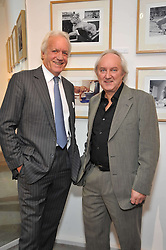 Left to right, JOHN RENDALL and photographer DEREK CATTANI at an exhibition of photographs and art works inspired by the story of Christian The Lion in aid of the George Adamson Wildlife Preservation Trust and the Born Free Foundation held at the Queen's Elm Gallery, 241 Fulham Road, London on 15th October 2009.