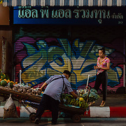 Street vendor selling fresh fruit in evening in Chaing Mai