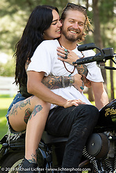 Hooligan racer Ethan White and his girlfriend tattoo artist Mara Ohara during the Sturgis Black Hills Motorcycle Rally. SD, USA. Friday, August 9, 2019. Photography ©2019 Michael Lichter.