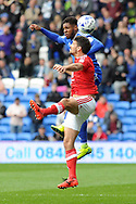 Cardiff's Kadeem Harris and Nottingham's Eric Lichaj challenge for a header. EFL Skybet championship match, Cardiff city v Nottingham Forest at the Cardiff City Stadium in Cardiff, South Wales on Easter Monday 17th April 2017.<br /> pic by Carl Robertson, Andrew Orchard sports photography.