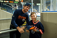 KELOWNA, BC - SEPTEMBER 23: James Neal #18 of the Edmonton Oilers signs autographs and poses with 10 year old Cohen Pike prior to practice at Prospera Place on September 23, 2019 in Kelowna, Canada. (Photo by Marissa Baecker/Shoot the Breeze)