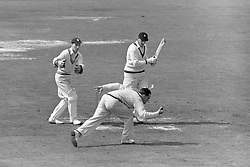 South Africa captain Jack Cheetham cuts a ball which is well held by England's Brian Close. Wicketkeeper Keith Andrew (l) watches on.