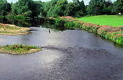 Man fishing on the River Tees, near Darlington, County Durham, England
