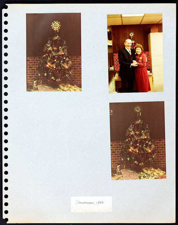 page from a photo album with company office workers having a good time USA Xmas 1982