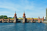 oberbaumbruecke bridge with subway passing over the pree river in berlin germany