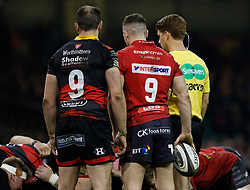 Dragons' Charlie Davies and Scarlets' Gareth Davies at the scrum<br /> <br /> Photographer Simon King/Replay Images<br /> <br /> Guinness PRO14 Round 21 - Dragons v Scarlets - Saturday 28th April 2018 - Principality Stadium - Cardiff<br /> <br /> World Copyright © Replay Images . All rights reserved. info@replayimages.co.uk - http://replayimages.co.uk