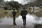 Major Dale Bell and the Mississippi Dept of Wildlife and Fisheries SRT (search and rescue team) surveys the Westbrook Road area in Jackson after the crest of the Pearl River.  The Pearl River has over flowed its banks and flooded this neighborhood and threatens many more and the water will not receded for days Photo©SuziAltman